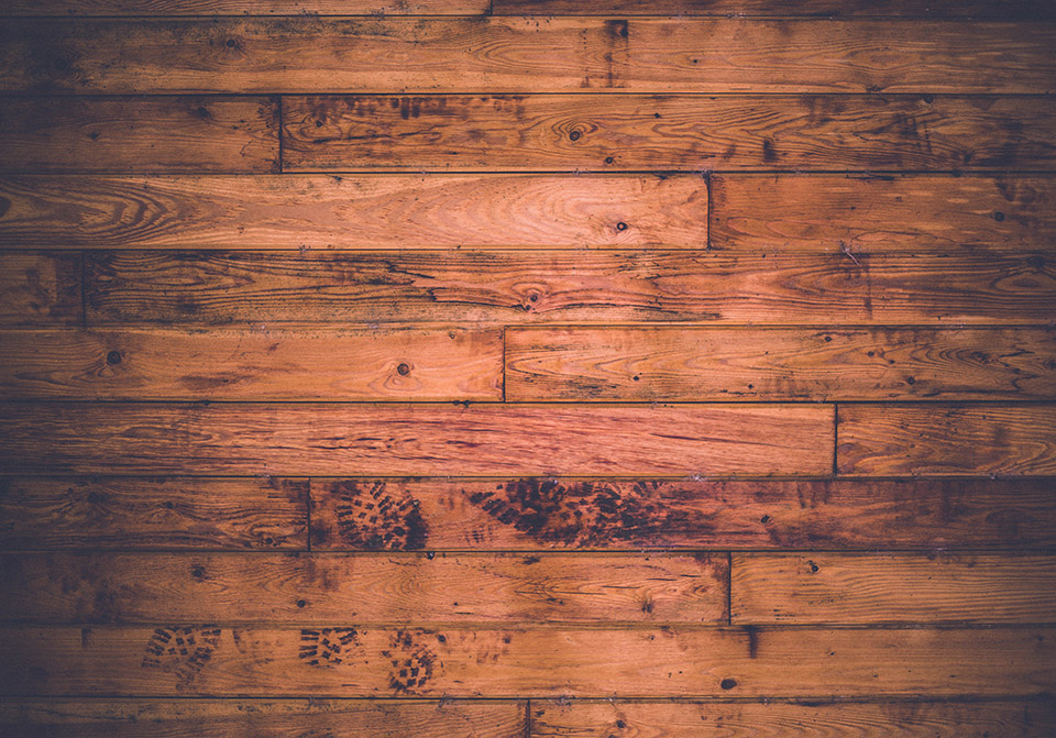 Photo of stained floor boards (Photo by Keith Misner on Unsplash)