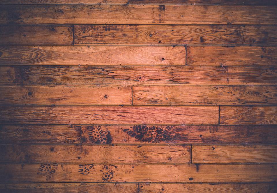 Photo of stained floor boards (Photo byKeith MisneronUnsplash)